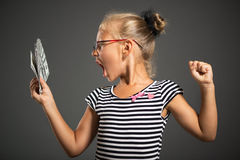Little girl with money Royalty Free Stock Photo