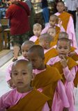 Little Girl Monk in a row Royalty Free Stock Photos