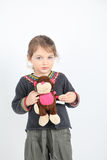 Little girl with monkey toy Stock Photos
