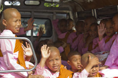 Little girl monks in a van Stock Images