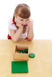 Little girl in a Montessori kindergarten studying Royalty Free Stock Photography
