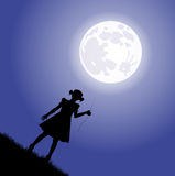 Little girl and the moon Stock Image