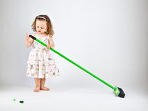Little girl with mop. On gray background Stock Photo