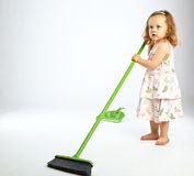 Little girl with mop. On gray background Stock Images
