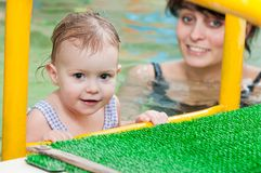Little girl and mothe in swimming Stock Images