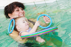 Little girl and mothe in swimming pool Royalty Free Stock Images