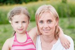 Little girl with mother Stock Photo