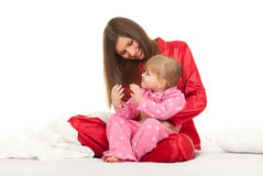Little girl with mother Stock Images
