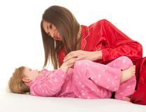 Little girl with mother Stock Photos