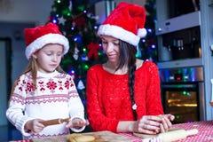 Little girl and mother baking Christmas Stock Photo