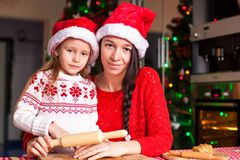 Little girl and mother baking Christmas Stock Photography