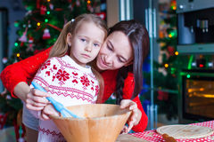 Little girl and mother baking Christmas Royalty Free Stock Images