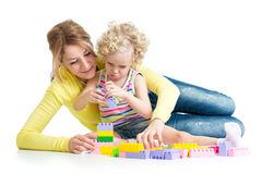 Little girl and mother with building blocks Stock Image