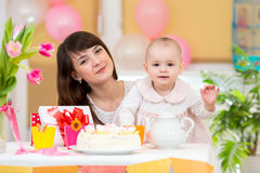 Little girl and mother celebrate birthday Royalty Free Stock Images
