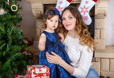Little girl and mother with Christmas tree and decoration Stock Photo