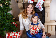 Little girl and mother with Christmas tree and decoration Royalty Free Stock Photos