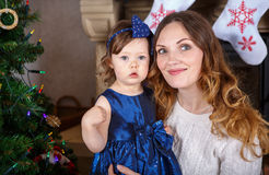 Little girl and mother with Christmas tree and decoration Royalty Free Stock Photography