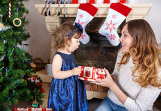Little girl and mother with Christmas tree and decoration Stock Image