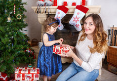 Little girl and mother with Christmas tree and decoration Royalty Free Stock Photo