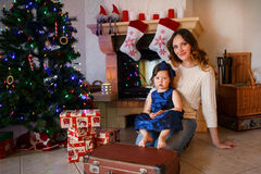 Little girl and mother with Christmas tree and decoration Royalty Free Stock Images