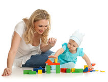 Little girl and mother with color building blocks Stock Photography