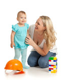Little girl and mother with construction set. And hard hat Stock Image