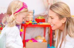 Little girl with mother having fun Stock Images