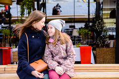 Little girl with mother hugging in the city street Royalty Free Stock Images