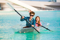 Little girl with mother kayak Stock Photography