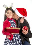 Little girl and Mother kissing and giving Xmas Present Royalty Free Stock Images