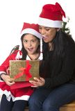 Little girl and Mother kissing and giving Xmas Present Royalty Free Stock Photo