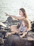 Little girl and mother looking far away with binoculars Royalty Free Stock Images