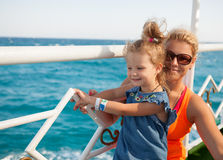 Little girl with mother looking at sea Stock Photography