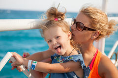 Little girl with mother looking at sea Stock Image