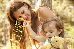Little girl and mother in the park Stock Photos