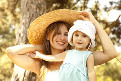 Little girl and mother in the park Stock Image