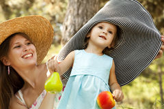 Little girl and mother in the park Stock Images