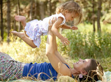 Little girl and mother in the park Royalty Free Stock Photo
