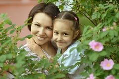Little  girl with  mother in park Royalty Free Stock Photos