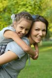 Little  girl with  mother in park Royalty Free Stock Image