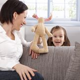 Little girl and mother playing Stock Photography