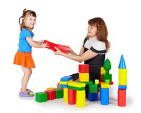 Little girl with mother playing with blocks. Little girl with mother playing with colored blocks on white background stock photos