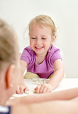 Little girl with mother playing domino Royalty Free Stock Images