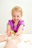 Little girl with mother playing domino Stock Photography
