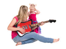 Little girl with mother  playing guitar Stock Photos