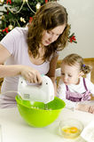 Little girl and mother are preparing cookies Royalty Free Stock Images
