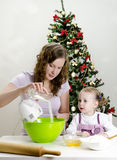 Little girl and mother are preparing cookies Stock Photography