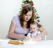 Little girl and mother are preparing cookies Royalty Free Stock Photo