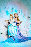 Little girl with mother in princess dress on a background of a w Stock Photos