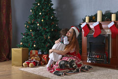 Little girl with mother in the room with Christmas decorations Stock Image